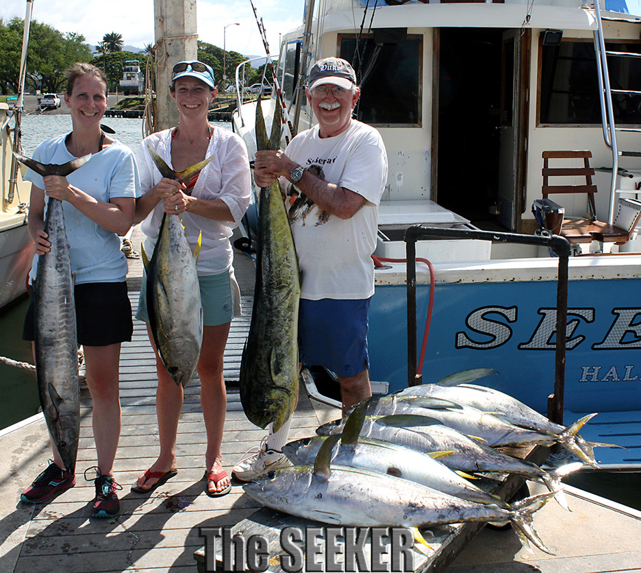 Ahi stacking the cart on the Seeker dock with a Mahi Mahi & an Ono (Wahoo) bonus